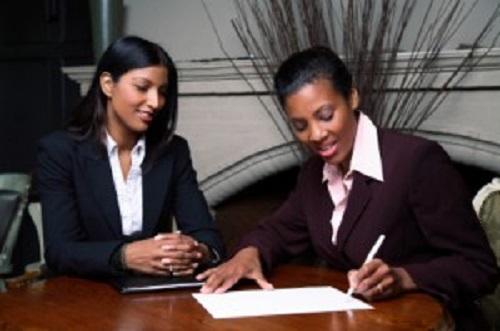 Happy couple signing documents